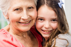 Grandmother and granddaughter embracing Stock Photo