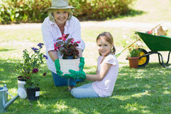 Grandmother and granddaughter engaged in gardening Royalty Free Stock Image