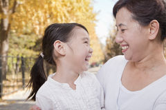 Grandmother and Granddaughter Enjoying the Park in Autumn Stock Photography