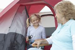 Grandmother And Granddaughter At Entrance To Tent Royalty Free Stock Photo