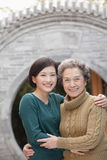 Grandmother and granddaughter in front of round arch, Beijing Stock Image