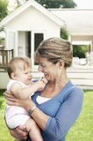 Grandmother And Granddaughter In Garden Royalty Free Stock Photography