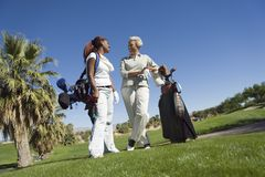 Grandmother and granddaughter on golf course Stock Photos