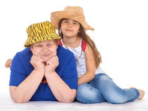 Grandmother and granddaughter in hats. Royalty Free Stock Photo