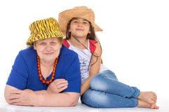 Grandmother and granddaughter in hats. Stock Photography