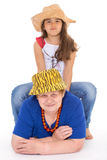 Grandmother and granddaughter in hats. Royalty Free Stock Image