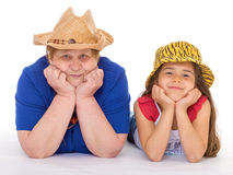 Grandmother and granddaughter in hats. Stock Photos