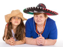 Grandmother and granddaughter in hats. Royalty Free Stock Images
