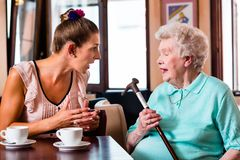 Granny and granddaughter at argument in cafe Stock Photography