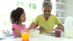 Grandmother And Granddaughter Having Breakfast Together stock video