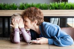 Grandmother and granddaughter having fun listening to music stock photos