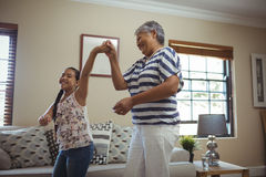 Grandmother and granddaughter having fun in living room Royalty Free Stock Photos