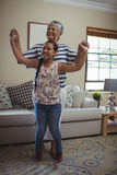 Grandmother and granddaughter having fun in living room Royalty Free Stock Image
