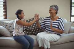 Grandmother and granddaughter having fun in living room Stock Image