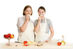 The grandmother and the granddaughter hold apple pieces Stock Images