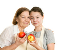 The grandmother and the granddaughter hold beautiful apples Royalty Free Stock Photo