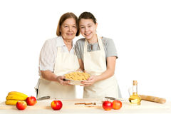 The grandmother and the granddaughter hold beautiful pie Royalty Free Stock Photo