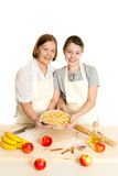 The grandmother and the granddaughter hold beautiful pie Royalty Free Stock Photos