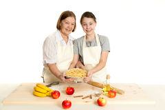 The grandmother and the granddaughter hold beautiful pie Royalty Free Stock Images