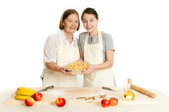 The grandmother and the granddaughter hold beautiful pie Stock Photos