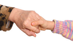 Grandmother and granddaughter hold hands. Stock Photography