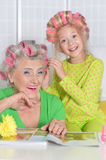 Grandmother with granddaughter at home Royalty Free Stock Photography