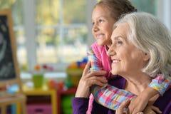 Grandmother and granddaughter hug Royalty Free Stock Photo