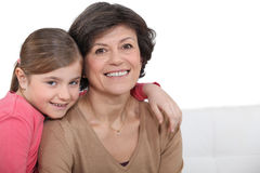 Grandmother and granddaughter hugging. Each other Royalty Free Stock Images