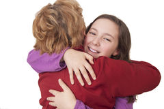 Grandmother and granddaughter hugging Stock Image