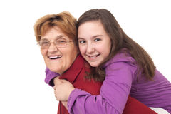 Grandmother and granddaughter hugging Stock Images