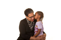 Grandmother and granddaughter isolated against a white background Royalty Free Stock Photography