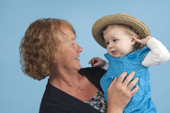 Grandmother with granddaughter, isolated on blue Stock Photos