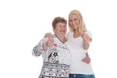Grandmother and granddaughter isolated making publicity. Royalty Free Stock Photo