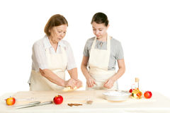 The grandmother and the granddaughter knead dough Royalty Free Stock Photo