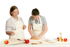 The grandmother and the granddaughter knead dough Royalty Free Stock Images