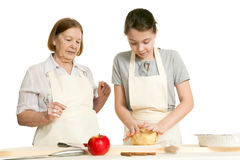 The grandmother and the granddaughter knead dough Stock Image
