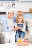 Grandmother and granddaughter knitting Royalty Free Stock Image