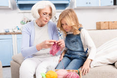 Grandmother and granddaughter knitting Royalty Free Stock Images
