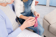 Grandmother and granddaughter knitting Stock Photo