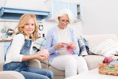 Grandmother and granddaughter knitting Royalty Free Stock Photo