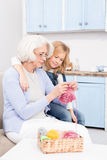 Grandmother and granddaughter knitting Stock Images