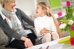 Grandmother and granddaughter laughing Royalty Free Stock Photos