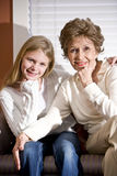 Grandmother and granddaughter in living room Royalty Free Stock Photography