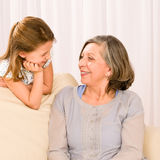 Grandmother and granddaughter look at each other Stock Image