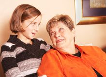 Grandmother and granddaughter look each other royalty free stock photography