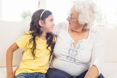 Grandmother and granddaughter looking at each other Royalty Free Stock Photography