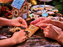 Grandmother and granddaughter make gingerbread house for Christmas . Royalty Free Stock Photos