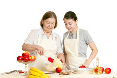 The grandmother and the granddaughter mix ingredients Stock Photo