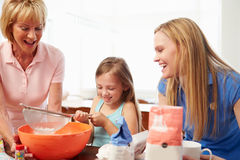Grandmother With Granddaughter And Mother Baking Together Stock Image