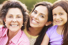 Grandmother With Granddaughter And Mother In Park Royalty Free Stock Photos